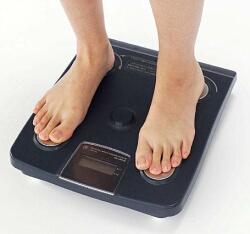 体重 を 測る